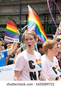 2018 JUNE 24 NEW YORK: American actress and activist Cynthia Nixon and supporters march the 5th Ave parade route during the NYC Pride March.