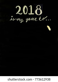 """2018 is my year to ..."" message written with chalk on a blackboard with space for copy."