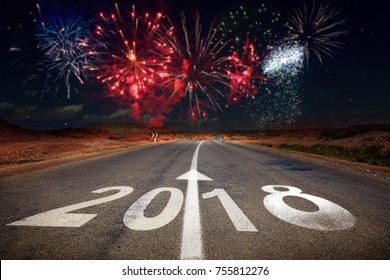 2018 New Year celebration fireworks on the road asphalt. New Year arrival concept