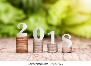 2018 New year on coins stack for saving money and financial planning concept