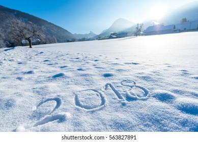 2018 numbers written on an austrian snow field