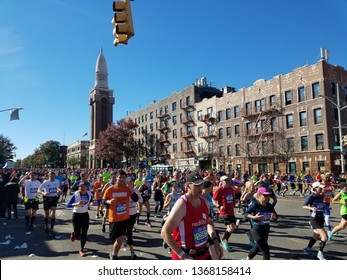 2018 NYC Marathon runners on 4th Ave and 41st Street in Brooklyn, New York, USA.  Nov 4th, 2018.