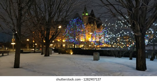 2018 photo of a downtown winter scene on Christmas day of the historic Chateau Laurier hotel Ottawa Ontario Canada.