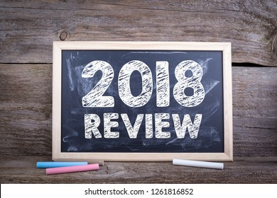 2018 review concept. Chalk board Background