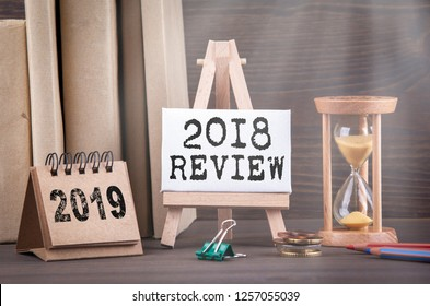 2018 review concept. Sandglass, hourglass or egg timer on wooden table showing the last second or last minute or time out