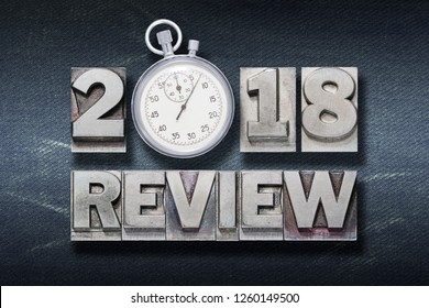 2018 review phrase made from metallic letterpress with stopwatch instead of O