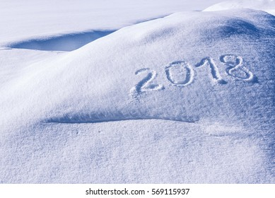 2018 sign drawn at snow with some copy space