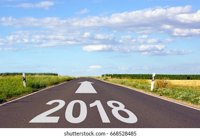 2018 - street with arrow and year