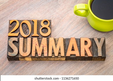 2018 summary word abstract in vintage letterpress wood type with a cup of coffee