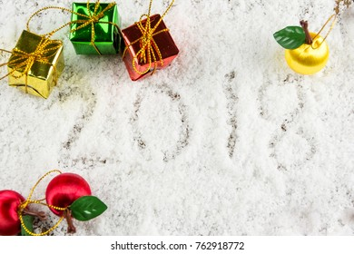 2018 text on the snow with Christmas and New Year decoration