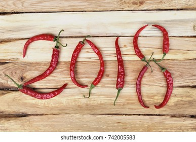 2018 written with red hot chili peppers on wooden background