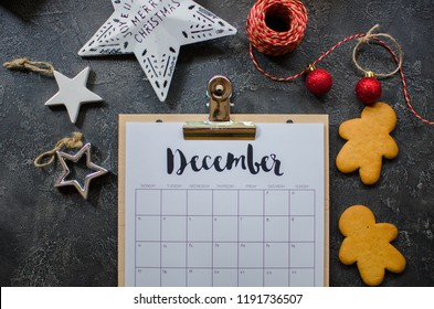 2018 year end review, date planning, appointment, deadline or holiday concept on wooden table next to black clean calendar on month of December.
