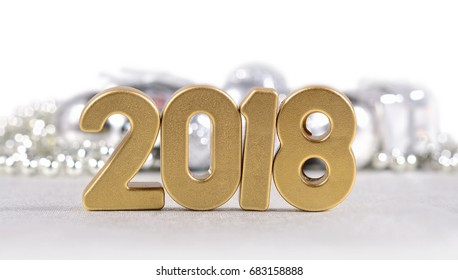 2018 year golden figures and Christmas decorations on a white background