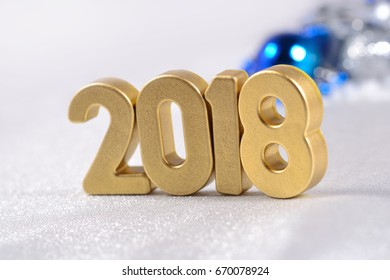 2018 year golden figures on the background of silvery and blue Christmas decorations