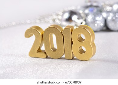 2018 year golden figures on the background of silvery Christmas decorations