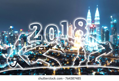 2018 years of ai technology , industry 4.0 , artificial intelligence trend concept. Silhouette of automation robot arms. Blur metropolis city building background.