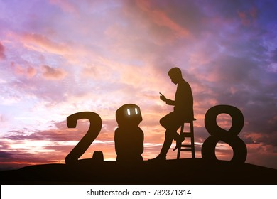 2018 years of robot assistant technology , industry 4.0 , artificial intelligence trend concept. Silhouette of business man talking to automation robo advisor. Vivid twilight sunset sky background.