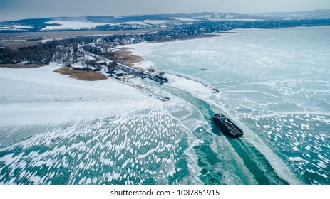 2018.02.28 Hungary, SzantodCar Ferry Boat with rows of cars is leaving the port on Hungary. Car and boat transportation on the frozen lake balaton. 2018.02.28 Hungary, Szantod