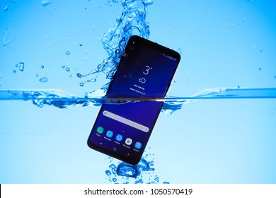 2018-03-16 Riga, Latvia. Samsung Galaxy S9+ dipped in water to showcase it's water resistance. Images shot for editorial use only.