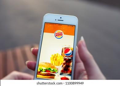 2018.04.23 Kazan Russia - Burger King app on Apple iphone 5 SE screen.