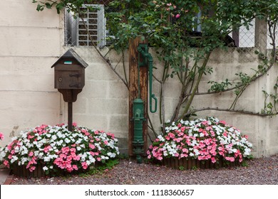 2018-06-15 Normandy France. Mailbox and flowers in front of a house in medieval village of Beuvron en Auge in Normandy France