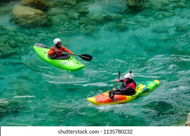 2018-07-01, Slovenia, Socha valley. Two kayakers on the emerald water of Socha river in Slovenia, top view.  Popular destination for active sports