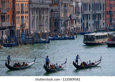 2018-07-03 Venice, Italy. Gondolas on the Grand Canal in Venice, Italy. Popular summer Europe travel destination