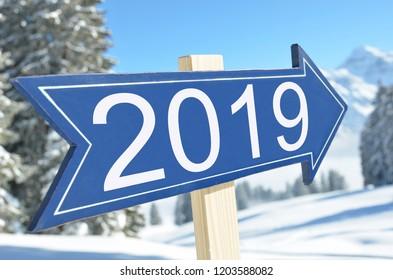 2019 arrow against snowy mountains