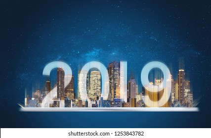 2019 augmented reality technology. Building hologram on digital tablet with new year 2019