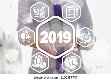 2019 Business Strategy Concept. Two thousand nineteenth year strategic plan finance web technology. Beautiful girl clicks a number 2019 year surrounded by specific icons.