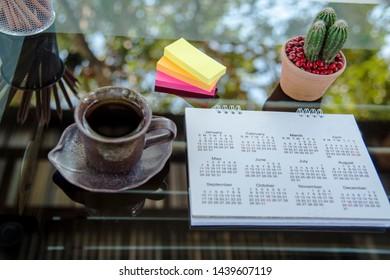 2019 calendar desk planner agenda plan on schedule event. Timetable agenda by organizer schedule. Calendar event plan concept.