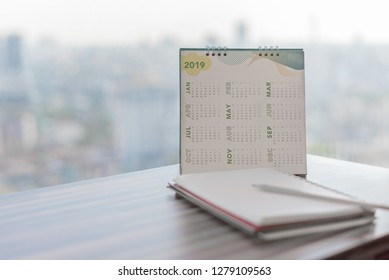 2019 Calendar on table in modern office with diary pencil notebook with blurred background. Planning for business year event schedule appointment booking timeline reminder Calendar Concept.