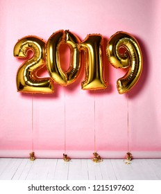 2019 Christmas inflatable gold numbers balloons on pink background for new year celebration