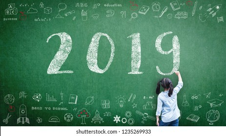2019 class calendar new year greeting by kid's hand drawing on school teacher's chalkboard with student's educational doodle for academic year, education classroom schedule concept