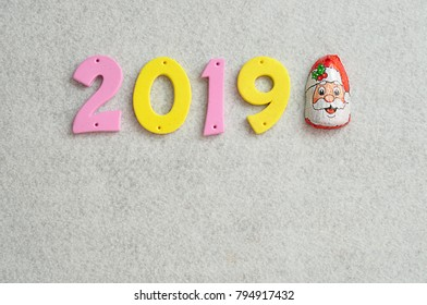 2019 displayed with a chocolate in a Santa Clause wrapper