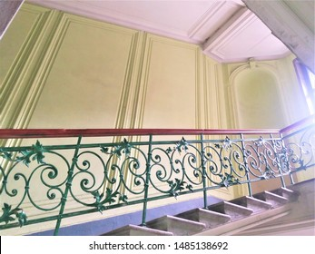 - , 2019. Forged internal staircase in the stairwell of an old residential building in St. Petersburg after repair. Details and design elements. Architecture. Beauty, vintage, style. Green, yellow