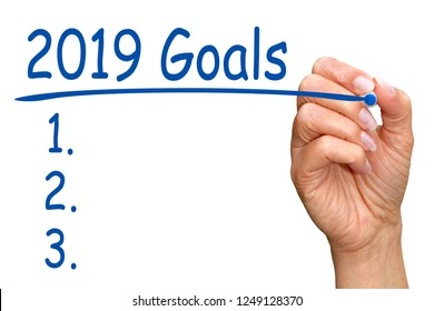 2019 Goals and Checklist - female hand with blue pen on white background