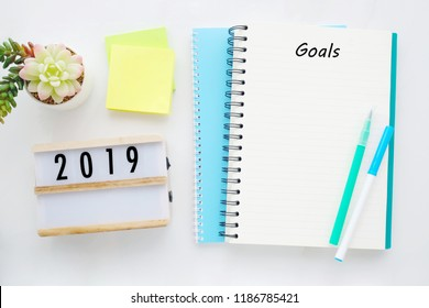 2019 goals on blank note paper background, new year aim to success in business background