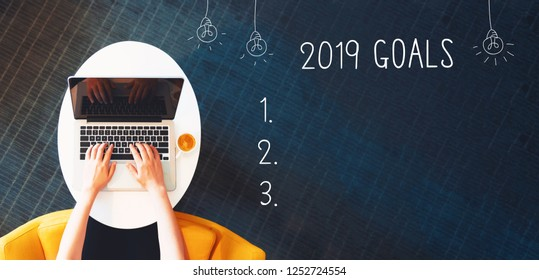 2019 goals with person using a laptop on a white table
