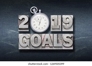 2019 goals phrase made from metallic letterpress with stopwatch instead of O