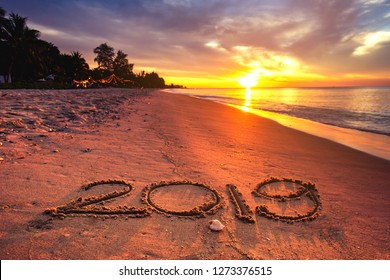 2019 hand writing on sunset beach under warm light. Image background for New year 2019 celebrate or Holiday vacation summer on the beach.