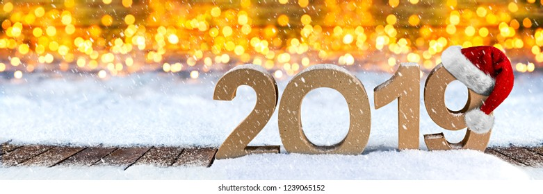 2019 happy new year christmas wide panorama greeting card number santa claus hat symbol lettering wooden snow background golden lights bokeh concept