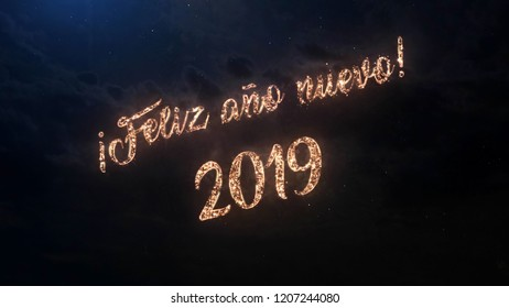 2019 Happy New Year greeting text in Spanish with particles and sparks on black night sky with colored fireworks on background, beautiful typography magic design.