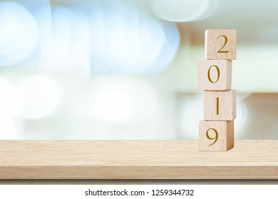 2019 happy new year greeting card, Wooden cubes with 2019 over blur bokeh background with copy space for text, Happy new year banner