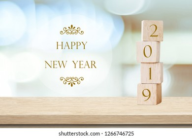 2019 happy new year greeting card, Wooden cubes with 2019 and Happy new year celebration over blur bokeh background, Happy new year banner