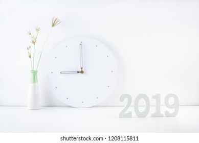 2019 happy new year theme, professional designer office concept : Business work space / modern workplace and decorative supplies place on desk table e.g number 2019 white wood cut, wall clock, vase