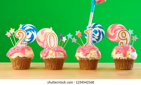 2019 Happy New Year's candyland lollipop drip cupcakes on green chroma key background.
