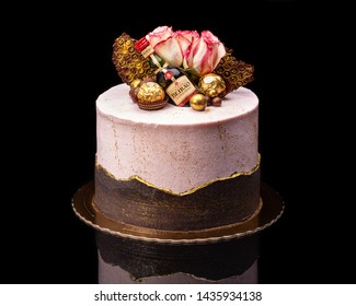 2019 June 12 Portugal Delicious chocolate cake for the holiday with a bottle Beirao and chocolates ferrero roshe.