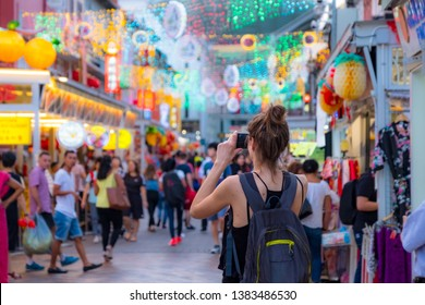 2019 March 1st, Singapore, Chinatown - People walking and shopping on the street market after sunset.