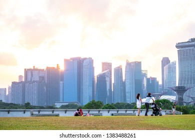 2019 March 1st, Singapore, Marina Barrage - Panorama view of the city buildings and people doing their activities at sunset..